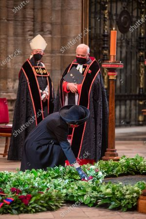 Her Royal Highness Camilla Duchess of Cornwall lays her flowers on The Grave of the Unknown Warrior watched by by The The Very Reverend John Hall, The Very Reverend Dr David Hoyle and the Archbishop of Canterbury.