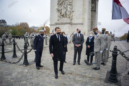 French President Emmanuel Macron (front) speaks with French Prime Minister Jean Castex (C), French Armies Chief of Staff General Francois Lecointre (R), French Junior Defence Minister Genevieve Darrieussecq (2ndR) and French Defence Minister Florence Parly (L) during a ceremony at the Arc de Triomphe in Paris