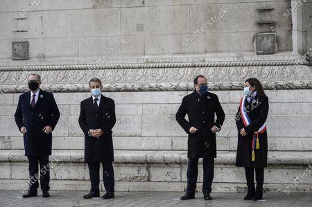 Richard Ferrand, Nicolas Sarkozy with Anne Hidalgo and Francois Hollande during a ceremony at the Arc de Triomphe in Paris