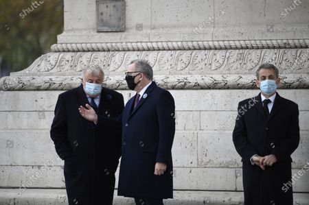 Gerard Larcher and Richard Ferrand and Nicolas Sarkozy during a ceremony at the Arc de Triomphe in Paris