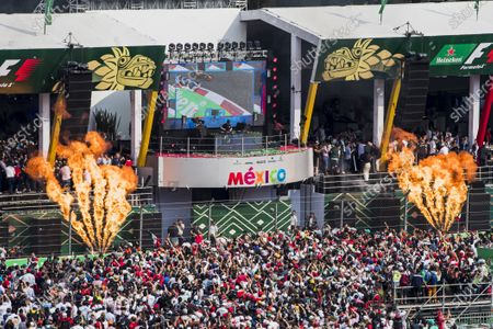 Autodromo Hermanos Rodriguez, Mexico City, Mexico. Sunday 29 October 2017. The background revolves to reveal top DJ, Hardwell, on the podium behind Max Verstappen, Red Bull, 1st Position, Valtteri Bottas, Mercedes AMG, 2nd Position, andKimi Raikkonen, Ferrari, 3rd Position. World Copyright: Zak Mauger/LAT Images