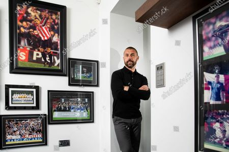 England and Sunderland striker Kevin Phillips at home in Lichfield in his office with football memories and England Caps.