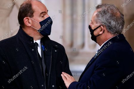 French Prime Minister Jean Castex (L) and President of the National Assembly Richard Ferrand (R) talk upon their arrival at the Pantheon, for a ceremony honouring the World War I soldiers and French author Maurice Genevoix who will be inducted to the Pantheon where key figures from France's history are honoured, in Paris, France, 11 November 2020, as part of the commemorations marking the 102nd anniversary of the 11 November 1918 Armistice, ending World War I (WWI). France on 11 November moves the remains of World War I writer Maurice Genevoix into its Pantheon of national heroes in Paris, an honour championed by the French president to encourage remembrance of the conflict. Genevoix wrote five memoirs of his time as a frontline soldier experiencing the horrors of trench warfare in the conflict, which he later collected into a single book 'Ceux de 14' ('Men of 14').