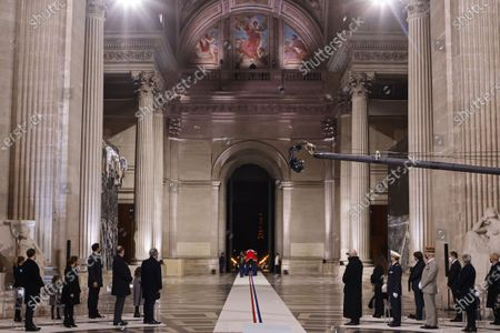 (L-R) Family members, French Prime Minister Jean Castex and President of the National Assembly Richard Ferrand stand as Republican guards acting as pallbearers carry the coffin of French author Maurice Genevoix inside the Pantheon, during a ceremony honouring the World War I soldiers and Maurice Genevoix who will be inducted to the Pantheon where key figures from France's history are honoured, in Paris, France, 11 November 2020, as part of the commemorations marking the 102nd anniversary of the November 11, 1918 Armistice, ending World War I (WWI).  France on November 11 moves the remains of World War I writer Maurice Genevoix into its Pantheon of national heroes in Paris, an honour championed by the French president to encourage remembrance of the conflict. Genevoix wrote five memoirs of his time as a frontline soldier experiencing the horrors of trench warfare in the conflict, which he later collected into a single book 'Ceux de 14' (Men of 14).