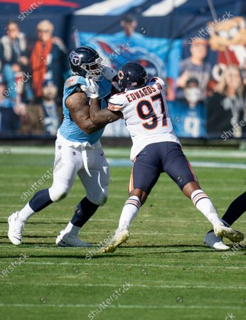 Stock Image of Tennessee Titans offensive guard Rodger Saffold III (76) plays against Chicago Bears defensive end Mario Edwards Jr. (97) during an NFL football game, in Nashville, Tenn
