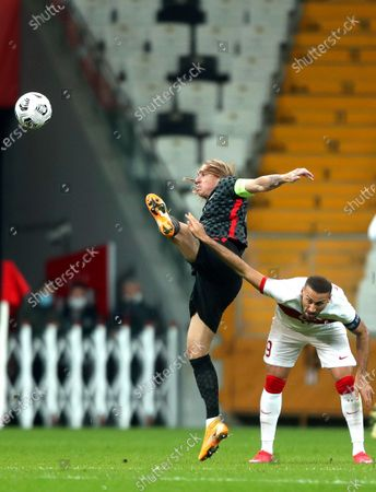 Domagoj Vida (L) of Croatia in action against Cenk Tosun (R) of Turkey during the International Friendly soccer match between Turkey and Croatia in Istanbul, Turkey, 11 November 2020 (issued on 12 November 2020). Croatia's captain Domagoj Vida has been tested positive for the coronavirus COVID-19 disease early 12 November 2020 after playing the first half of the 3-3 draw with Turkey.