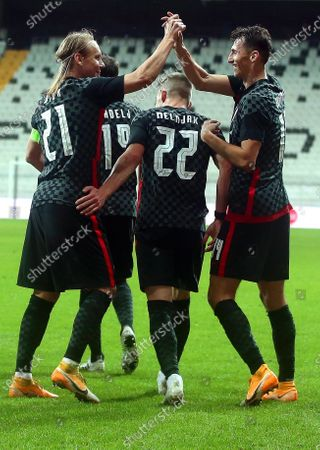 Ante Budimir (R) of Croatia celebrates with teammate Domagoj Vida (L) after scoring the 1-1 equalizer during the International Friendly soccer match between Turkey and Croatia in Istanbul, Turkey, 11 November 2020 (issued on 12 November 2020). Croatia's captain Domagoj Vida has been tested positive for the coronavirus COVID-19 disease early 12 November 2020 after playing the first half of the 3-3 draw with Turkey.