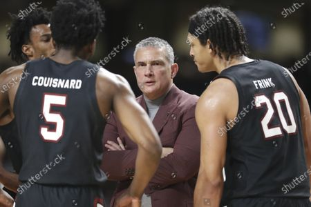 Stock Image of South Carolina head coach Frank Martin talks to Jermaine Couisnard (5) and Alanzo Frink (20) in the second half of an NCAA college basketball game against Vanderbilt in Nashville, Tenn. South Carolina coach Frank Martin carries a new perspective into this season with the Gamecocks. Martin caught COVID-19 during the spring when fear of the disease was spiking and few people knew how to deal with it. But Martin's time in isolation and recovery led to a deeper appreciation of when he and his players would return to the court