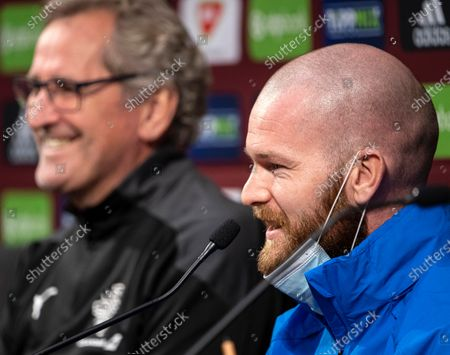 Captain of the Icelandic national team Aron Gunnarsson shares a smile with head coach Erik Hamren (L) during a press conference in Puskas Arena in Budapest, Hungary, 11 November 2020. Iceland will face Hungary in their UEFA EURO 2020 qualification play-off soccer match on 12 November 2020.