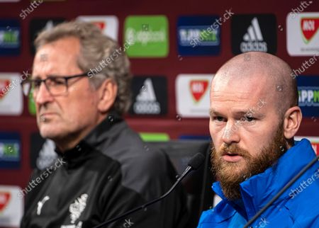 Captain of the Icelandic national team Aron Gunnarsson next to head coach Erik Hamren (L) attends a press conference in Puskas Arena in Budapest, Hungary, 11 November 2020. Iceland will face Hungary in their UEFA EURO 2020 qualification play-off soccer match on 12 November 2020.