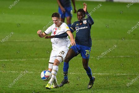 Southampton U-21 midfielder Lucas Defise (74) battles for possession  with Milton Keynes Dons midfielder John Freeman (30) during the EFL Trophy South Group C match between Milton Keynes Dons and Southampton U21 at stadium:mk, Milton Keynes, England