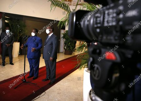 Ivorian President Alassane Ouattara (R) speaks with Henri Konan Bedie (L), former Ivorian head of state and current president of the National Transitional Council in Abidjan, Ivory Coast, 11 November 2020. Henri Konan Bedie has 'agreed' to dialogue with Ivorian President Alassane Ouattara on the crisis linked to the presidential election of 31 October 2020.