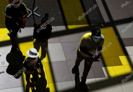 Stock Picture of Shoppers wearing face masks to protect against COVID-19, enter a shopping Mall in Johannesburg, . In an address to the nation, Thursday Nov. 11, 2020, President Cyril Ramaphosa said that people must continue wearing masks, as well as taking other precautions in a bid to prevent a second surge of the pandemic as experienced in other parts of the world