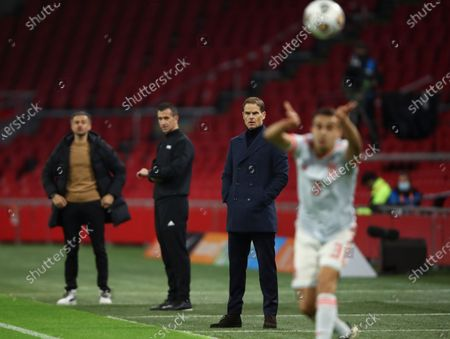 Netherlands' coach Frank de Boer, second right, watches his team during the international friendly soccer match between The Netherlands and Spain at the Johan Cruyff ArenA in Amsterdam, Netherlands, . Far left is Spain's coach Luis Enrique
