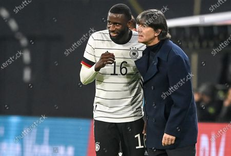 Germany's team head coach Joachim Loew talks with his player Antonio Ruediger (L) during the international friendly soccer match between Germany and Czech Republic in Leipzig, Germany, 11 November 2020.