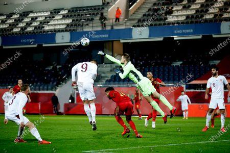 Belgium goalkeeper Simon Mignolet, center, punches the ball away after a shot on goal during an international friendly soccer match between Belgium and Switzerland at the King Power stadium in Leuven, Belgium