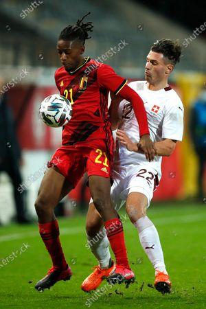 Belgium's Joris Kayembe, left, vies for the ball against Switzerland's Fabian Schar during an international friendly soccer match between Belgium and Switzerland at the King Power stadium in Leuven, Belgium