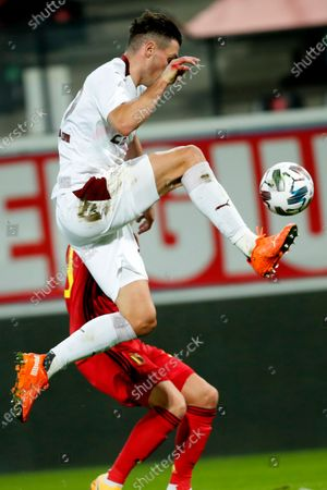 Switzerland's Fabian Schar, right, goes up against Belgium's Thorgan Hazard during an international friendly soccer match between Belgium and Switzerland at the King Power stadium in Leuven, Belgium