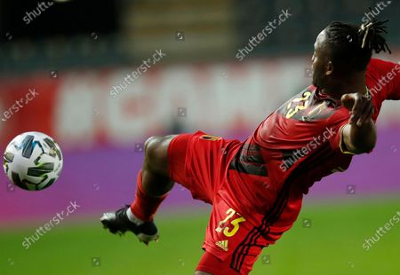 Belgium's Michy Batshuayi in action during an international friendly soccer match between Belgium and Switzerland at the King Power stadium in Leuven, Belgium, . At right is Switzerland's Fabian Schar