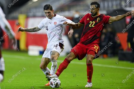 Switzerland's midfielder Steven Zuber (L) fights fot the ball with Belgium's midfielder Nacer Chadli during the friendly soccer match between Belgium and Switzerland at the Den Dreef stadium in Leuven, Belgium, 11 November 2020.