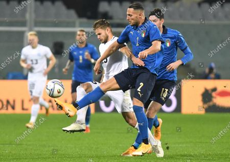 Estonia's forward Rauno Sappinen (L) against Italy's defender Danilo D'Ambrosio (R) during the friendly soccer match between Italy and Estonia at the Artemio Franchi stadium in Florence, Italy, 11 November 2020.