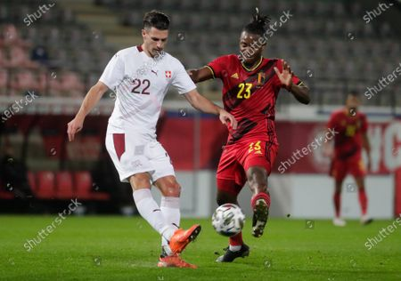 Fabian Schar of Switzerland (L) and Micky Batshuayi of Belgium in action during a friendly soccer match between Belgium and Switzerland at Den Dreef stadium in Leuven, Belgium, 11 November 2020.
