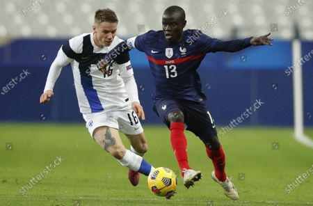 Stock Image of France's N'golo Kante (R) and Finland's Robert Taylor  in action during the friendly soccer match between France and Finland in Paris, France, 11 November 2020.