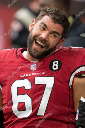 Arizona Cardinals offensive guard Justin Pugh (67) smiles prior to an NFL football game against the Miami Dolphins, in Glendale, Ariz