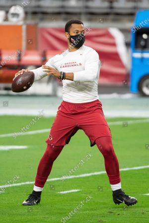 Stock Image of Arizona Cardinals quarterback Brett Hundley (7) warms up prior to an NFL football game against the Miami Dolphins, in Glendale, Ariz