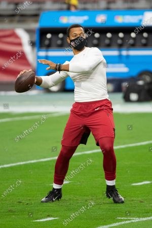 Stock Photo of Arizona Cardinals quarterback Brett Hundley (7) warms up prior to an NFL football game against the Miami Dolphins, in Glendale, Ariz