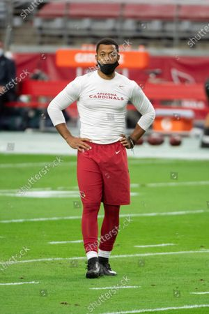 Arizona Cardinals quarterback Brett Hundley (7) stands on the field prior to an NFL football game against the Miami Dolphins, in Glendale, Ariz
