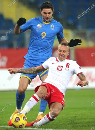 Jacek Goralski (R) of Poland and Roman Yaremchuk (L) of Ukraine in action during a friendly soccer match between Poland and Ukraine at Silesian stadium in Chorzow, Poland, 11 November 2020.