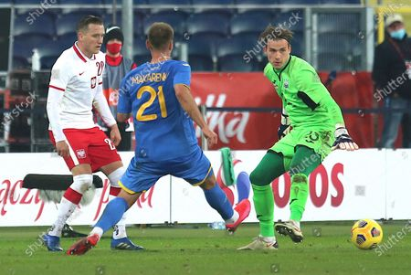 Piotr Zielinski (L) of Poland and Yevhen Makarenko (C) and Andriy Lunin (R) of Ukraine in action during a friendly soccer match between Poland and Ukraine at Silesian stadium in Chorzow, Poland, 11 November 2020.