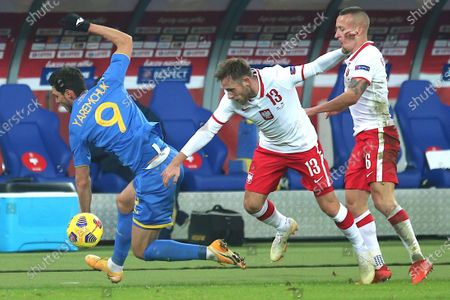 Maciej Rybus (C) and Jacek Goralski (R) of Poland and Roman Yaremchuk (L) of Ukraine in action during a friendly soccer match between Poland and Ukraine at Silesian stadium in Chorzow, Poland, 11 November 2020.
