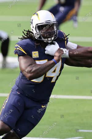 Los Angeles Chargers defensive end Melvin Ingram (54) rushes the passer during an NFL football game against the Las Vegas Raiders, in Inglewood, Calif