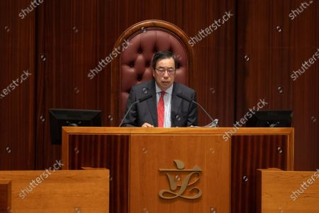 Legislative Council President Andrew Leung, (C) presides over a session at the Legislative Council in Hong Kong, China, 12 November 2020. Fifteen Hong Kong's opposition lawmakers resigned on 12 November to protest against the disqualification of four colleagues on 11 November after China's National People's Congress Standing Committee (NPCSC) empowered the local government to unseat politicians without having to go through the city's courts. The group is expected to officially hand in their resignation letter later in the day.