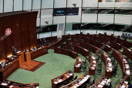 Legislative Council President Andrew Leung, (L), presides over a session at Legislative Council with expert pan-democrat seats in Hong Kong, China, 12 November 2020. Hong Kong's opposition lawmakers are expected to resign to protest against the disqualification of four colleagues after China's National People's Congress Standing Committee (NPCSC) empowered the local government to unseat politicians without having to go through the city's courts.