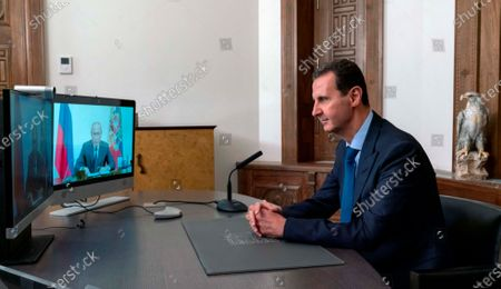 Released by the Syrian official news agency SANA, Syrian President Bashar Assad listens to Russian President Vladimir Putin during their talks via video conference, in Damascus, Syria. On Nov. 13, 1970, Hafez Assad a young career air force officer launched a bloodless coup. Fifty years later, Assad's family still rules Syria. The country is in ruins from a decade of civil war that killed around a half million people, displaced half the population and virtually wiped out the economy. But Hafez's son, Bashar Assad, has an unquestioned grip on what remains