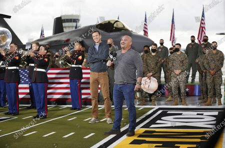 FOX NFL Sunday honored the U.S. military for Veterans Day as Cooper Manning, left, and Jay Glazer hosted live segments from Marine Corps Air Station Miramar surrounded by Marines and the 3rd Marine Aircraft Wing Band