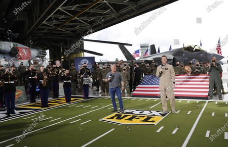 FOX NFL Sunday honored the U.S. military for Veterans Day as Jay Glazer, left, and Cooper Manning hosted live segments from Marine Corps Air Station Miramar surrounded by Marines and the 3rd Marine Aircraft Wing Band