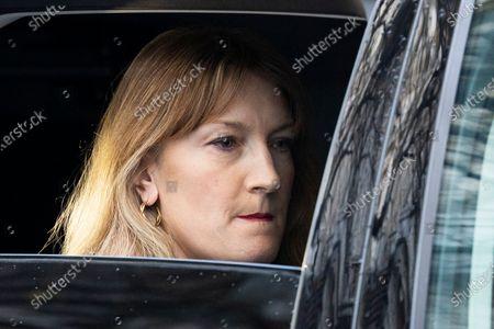 Stock Photo of Government spokesperson Allegra Stratton prepares to depart Downing Street.