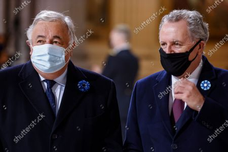 President of the French Senate Gerard Larcher, left, and and President of the National Assembly Richard Ferrand arrive inside the Pantheon monument, prior to a ceremony honouring the World War I soldiers and French author Maurice Genevoix, in Paris, Wednesday, Nov.11, 2020. French President Emmanuel Macron will lead a ceremony to enter World War I fighter Maurice Genevoix in the Pantheon monument, which holds the remains of France's most-revered figures. Genevoix authored a memoir called « Those of '14 » seen as a definitive account of the daily life of soldiers in the war