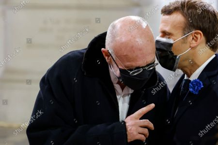 French President Emmanuel Macron, right, speaks with German artist Anselm Kiefer in the Pantheon monument in Paris, Wednesday, Nov.11, 2020. French President Emmanuel Macron led a ceremony to enter World War I fighter Maurice Genevoix in the Pantheon monument, which holds the remains of France's most-revered figures. Genevoix authored a memoir called « Those of '14 » seen as a definitive account of the daily life of soldiers in the war