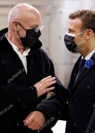 Stock Picture of French President Emmanuel Macron, right, speaks with German artist Anselm Kiefer in the Pantheon monument in Paris, Wednesday, Nov.11, 2020. French President Emmanuel Macron led a ceremony to enter World War I fighter Maurice Genevoix in the Pantheon monument, which holds the remains of France's most-revered figures. Genevoix authored a memoir called « Those of '14 » seen as a definitive account of the daily life of soldiers in the war