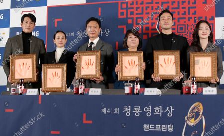 Stock Photo of From left, South Korean actors Jung Woo-sung, Cho Yeo-jeong, Jo Woo Jin, Lee Jung-eun, Park Hae Soo and Kim Hye Jun pose with their hand prints for the media during a hand printing ceremony for the 41st Blue Dragon Film Awards in Seoul, South Korea, . The Blue Dragon Film Awards will be held on Dec. 11