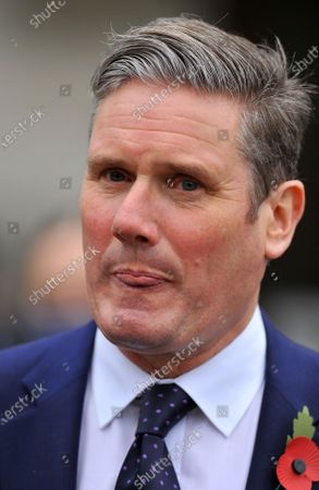 Stock Photo of Keir Starmer leaving Westminster Abbey.They were Heckled by protestors enroute to parliament A special service was being held at Westminster Abbey to mark the centenary of the burial of the Unknown Warrior. At 11:00 GMT, a two-minute silence was held to commemorate those who died in conflict. Armistice Day marks the day World War One ended in 1918. The grave of the Unknown Warrior represents those who died in the war and whose place of death is not known or whose remains are unidentified