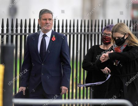 Keir Starmer leaving Westminster Abbey.They were Heckled by protestors enroute to parliament A special service was being held at Westminster Abbey to mark the centenary of the burial of the Unknown Warrior. At 11:00 GMT, a two-minute silence was held to commemorate those who died in conflict. Armistice Day marks the day World War One ended in 1918. The grave of the Unknown Warrior represents those who died in the war and whose place of death is not known or whose remains are unidentified