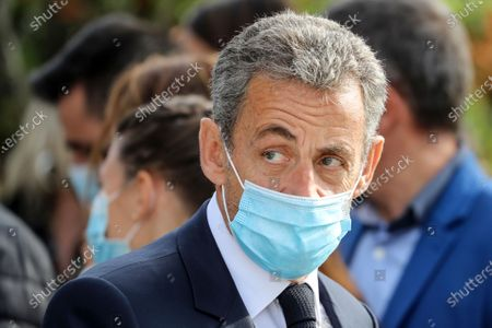 Former French President Nicolas Sarkozy attends a ceremony in Nice, southern France. Former French President Nicolas Sarkozy wants authorities to drop an investigation into alleged illegal financing of his 2007 campaign by the regime of late Libyan leader Moammar Gadhafi. A French-Lebanese businessman this week backtracked on claims he made in 2016 that he had handed Sarkozy suitcases of Libyan cash