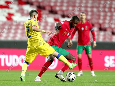 William Carvalho (front R) of Portugal vies with Cristian Martinez of Andorra during a friendly football match at the Luz stadium in Lisbon, Portugal, on Nov. 11, 2020.