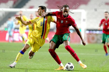 Ruben Semedo (front R) of Portugal vies with Aaron Sanchez of Andorra during a friendly football match at the Luz stadium in Lisbon, Portugal, on Nov. 11, 2020.
